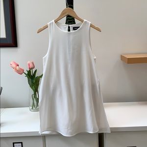 White Romper with overlay with slit on each side
